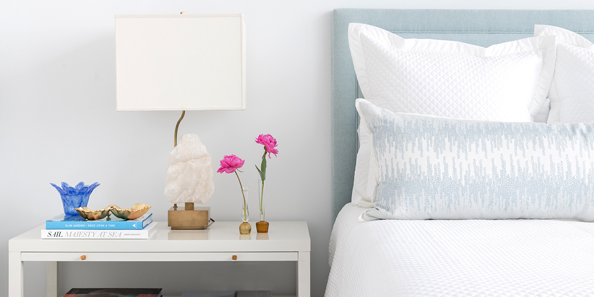 Bedrooom photo with side table and decor